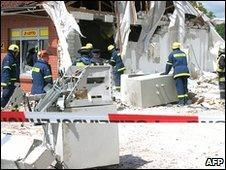 The fire brigade clear up at the site of a bank that was blown up in Malliss, northern Germany, 26 May 2010