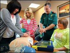 From left: responders Dianne Hawkins, Katie Gibby and Kristie Price receive training