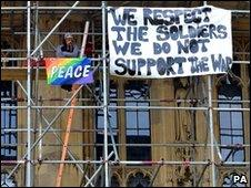 A protester on the scaffolding outside Parliament