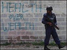 A police officer stands guard near Tivoli Gardens, Kingston