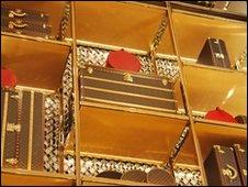 shelves of bags at Louis Vuitton store