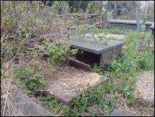 A delapidated box grave at Llanllechid graveyard