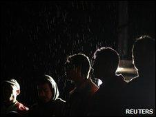 Evacuees in the rain near Pacaya volcano