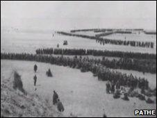 Soldiers lining the beach at Dunkirk