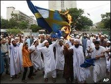 Protesters burn a Swedish flag in an anti-Facebook demonstration in Dhaka, Bangladesh (28 May 2010)