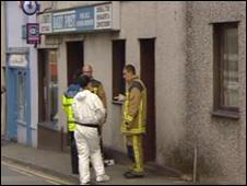 Fire and police officers at the scene of the fatal fire in Caernarfon