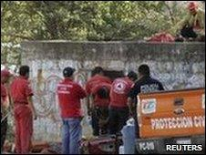 Rescue personnel inspect a ventilation shaft at the mine near Taxco