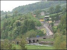 Motorists encounter a steep hill, before crossing a narrow bridge