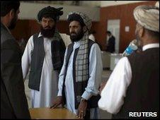Afghan delegates register to attend the upcoming peace Jirga in Kabul on 30 May 2010