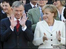 German President Horst Koehler and German Chancellor Angela Merkel (file pic, May 2009)