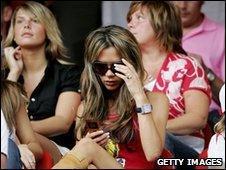 Victoria Beckham on mobile phone