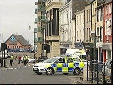 A police car in a sealed off street in Whitehaven
