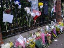 Flowers have been left at the scene of the shooting on the Shankill Road
