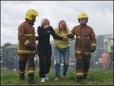Firefighters and actors playing casualties in Off The Rails in 2008