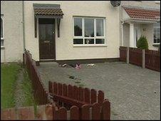 The armed men burst into the home shortly before midnight