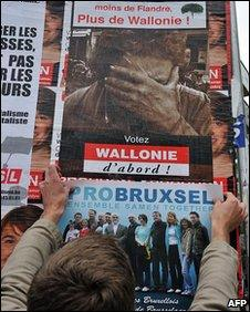 Man putting up election posters in Brussels, 1 June 2010