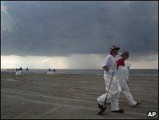 Storm clouds over clean-up workers