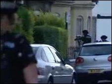 Armed police enter the house