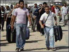 Palestinians head towards the Rafah crossing between Gaza and Egypt, 1 June 2010