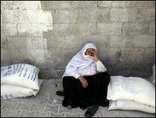 A woman waits to receive aid in Gaza City, 6 June 2010