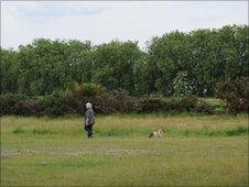 A woman walks her dog on Wanstead Flats, east London
