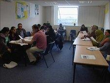 Immigrants taking an English class