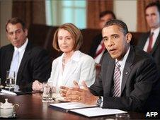 Barack Obama (right) in talks with congressional leaders including Nancy Pelosi, 10 June
