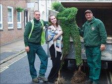 Members of Aylesbury Town Council with the damaged topiary footballer