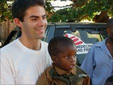 Dr Neil Stone and a child in Malawi