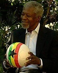 Former UN Secretary-General Kofi Annan holding a football