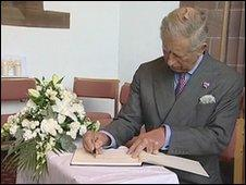 Prince Charles signs a book of condolence