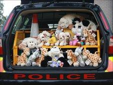 Toys in back of a police vehicle