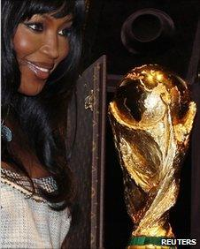 Model Naomi Campbell poses with the World Cup trophy in Paris, 1 June