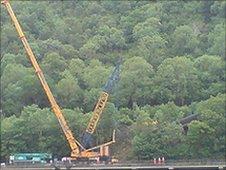 Crane removing derailed train