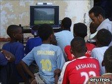 Football fans watch the opening World Cup match in Mogadishu