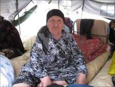 Elderly woman in refugee camp