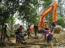 Bangladeshi army personnel clear the area in Cox's Bazar, on June 15, 2010