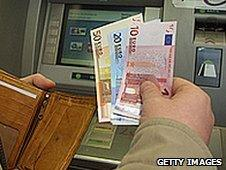 Man withdrawing euros from cashpoint (file pic)