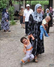 An ethnic Uzbek mother with her children inside a refugee camp at Begabad on the Kyrgyz-Uzbek border, 15 June