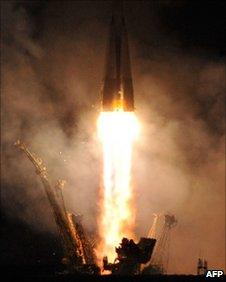 Soyuz lifts off (AFP)