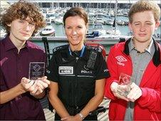 Connor Macey, Det Sgt Jackie Shaw and Harry Oswin at Brighton Marina