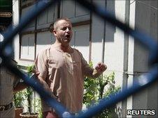 Jeff Savage walks to the court room at Pathumwan Municipal court in Bangkok