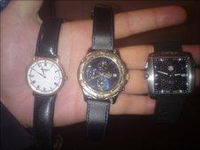 Stephen Taylor holding the stolen watches