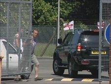 A car is let through the gates
