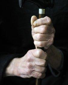 Older man holding a walking stick