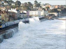 Waves breaking over rail line at Dawlish