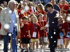 Michael Gambon (L) and Daniel Radcliffe (C) celebrate with fans