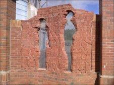 The carved brick sculpture was almost completed when it was attacked