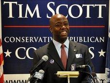 Tim Scott standing in front of microphones