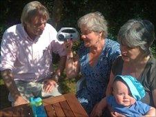The Caufield family listen to the match on a wind-up radio